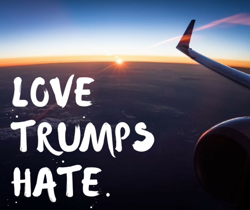 plane image with words love trumps hate